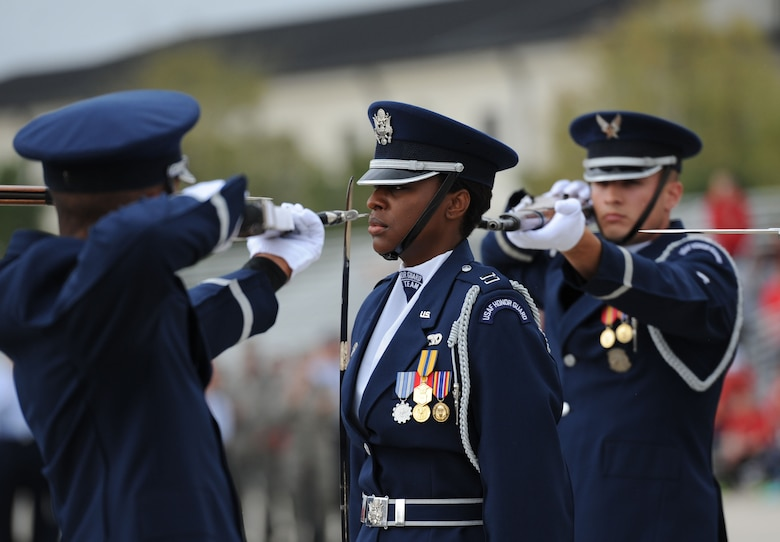 Capt. Angele Montfort, U.S. Air Force Honor Guard Drill Team commander, participates in the debut performance of the team's 2017 routine during the 81st Training Group drill down at the Levitow Training Support Facility drill pad March 10, 2017, on Keesler Air Force Base, Miss. The team comes to Keesler every year for five weeks to develop a new routine that they will use throughout the year. (U.S. Air Force photo by Kemberly Groue)