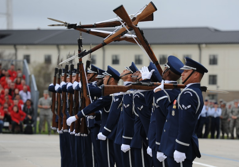 The U.S. Air Force Honor Guard Drill Team debuts their 2017 routine during the 81st Training Group drill down at the Levitow Training Support Facility drill pad March 10, 2017, on Keesler Air Force Base, Miss. The team comes to Keesler every year for five weeks to develop a new routine that they will use throughout the year. (U.S. Air Force photo by Kemberly Groue)
