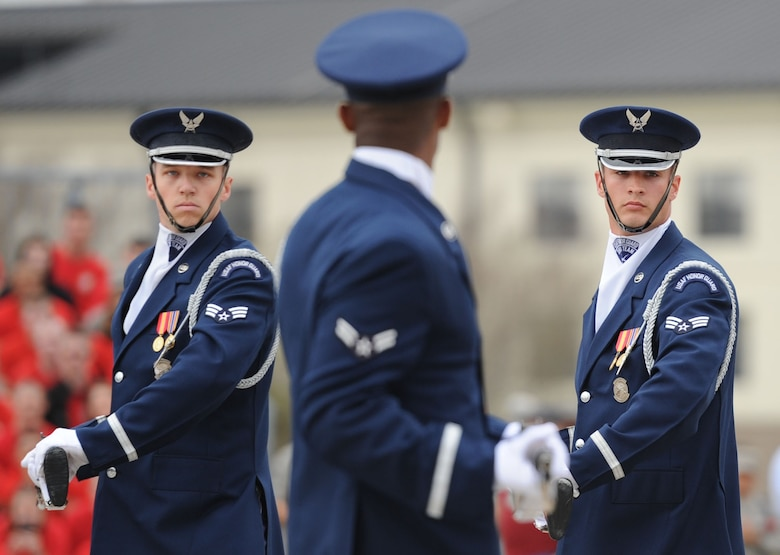 Senior Airman Scott Gricius, Airman 1st Class Nigel Jaggard and Senior Airman Tyler Reynolds, U.S. Air Force Honor Guard Drill Team members, debut the team's 2017 routine during the 81st Training Group drill down at the Levitow Training Support Facility drill pad March 10, 2017, on Keesler Air Force Base, Miss. The team comes to Keesler every year for five weeks to develop a new routine that they will use throughout the year. (U.S. Air Force photo by Kemberly Groue)