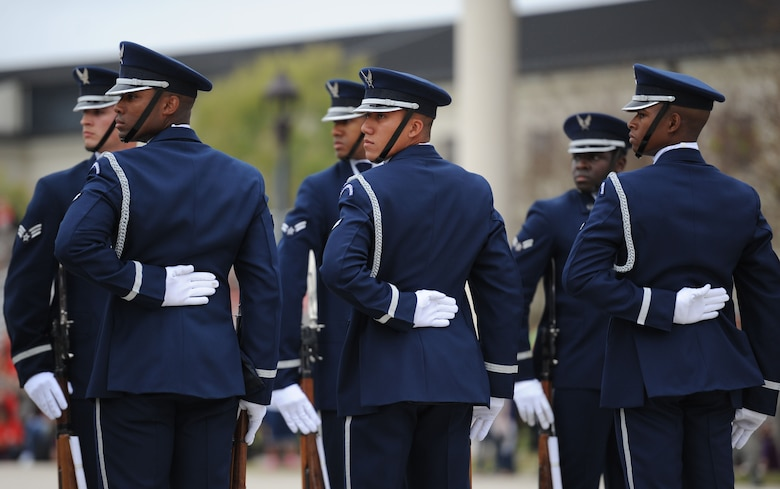 The U.S. Air Force Honor Guard Drill Team performs their new routine during the 81st Training Group drill down at the Levitow Training Support Facility drill pad March 10, 2017, on Keesler Air Force Base, Miss. The team comes to Keesler every year for five weeks to develop a new routine that they will use throughout the year. (U.S. Air Force photo by Kemberly Groue)
