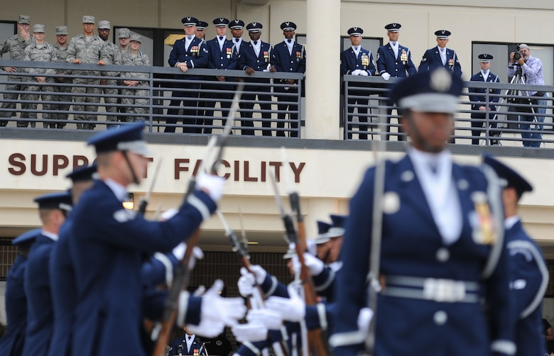 Members of the U.S. Air Force Honor Guard Drill Team watch from the balcony as fellow members debut  their 2017 routine during the 81st Training Group drill down at the Levitow Training Support Facility drill pad March 10, 2017, on Keesler Air Force Base, Miss. The team comes to Keesler every year for five weeks to develop a new routine that they will use throughout the year. (U.S. Air Force photo by Kemberly Groue)