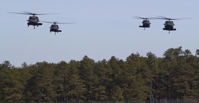 Army Reserve UH-60 Black Hawk helicopters from 8th Battalion, 229th Aviation Regiment, based out of Fort Knox, Ky., approach Lakehurst Maxfield Field during a multi-component airfield seizure training exercise between the Army Reserve and the 101st Airborne Division (Air Assault) on March 13, 2017, to kick off Warrior Exercise 78-17-01. Several Army Reserve organizations including the Army Reserve Aviation Command, 84th Training Command, 78th Training Division, and members of the 200th Military Police Command helped Easy Company, 2nd Battalion, 506th Parachute Infantry Regiment, 101st Airborne Division conduct the mission. Roughly 60 units from the U.S. Army Reserve, U.S. Army, U.S. Air Force, and Canadian Armed Forces are participating in the 84th Training Command's joint training exercise, WAREX 78-17-01, at Joint Base McGuire-Dix-Lakehurst from March 8 until April 1, 2017; the WAREX is a large-scale collective training event designed to assess units' combat capabilities as America's Army Reserve continues to build the most capable, combat-ready, and lethal Federal Reserve force in the history of the Nation. (Army Reserve Photo by Master Sgt. Mark Bell / Released)