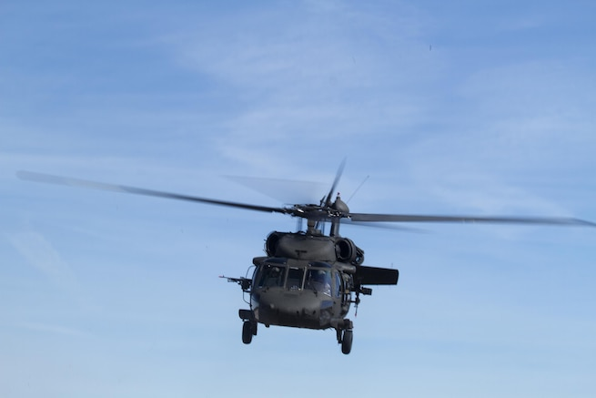 Army Reserve UH-60 Black Hawk helicopter from 8th Battalion, 229th Aviation Regiment, based out of Fort Knox, Ky., approaches Lakehurst Maxfield Field during a multi-component airfield seizure training exercise between the Army Reserve and the 101st Airborne Division (Air Assault) on March 13, 2017, to kick off Warrior Exercise 78-17-01. Several Army Reserve organizations including the Army Reserve Aviation Command, 84th Training Command, 78th Training Division, and members of the 200th Military Police Command helped Easy Company, 2nd Battalion, 506th Parachute Infantry Regiment, 101st Airborne Division conduct the mission. Roughly 60 units from the U.S. Army Reserve, U.S. Army, U.S. Air Force, and Canadian Armed Forces are participating in the 84th Training Command's joint training exercise, WAREX 78-17-01, at Joint Base McGuire-Dix-Lakehurst from March 8 until April 1, 2017; the WAREX is a large-scale collective training event designed to assess units' combat capabilities as America's Army Reserve continues to build the most capable, combat-ready, and lethal Federal Reserve force in the history of the Nation. (Army Reserve Photo by Master Sgt. Mark Bell / Released)