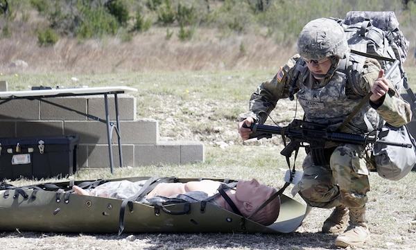 Sgt. Ashley Murphy, Fort Hood Dental Activity, prepares to evacuate a casualty during Army Warrior Task Lane during the Regional Best Warrior Competition hosted by the Joint Base San Antonio-Fort Sam Houston Dental Health Activity, or DENTAC, from Feb. 27 to March 3 at JBSA-Camp Bullis.