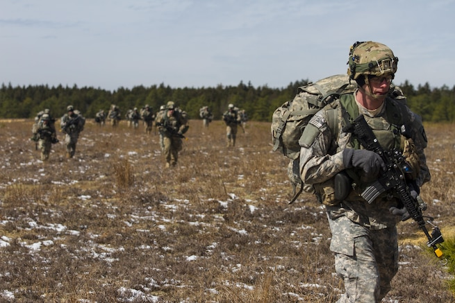 Army Soldiers assigned to the 101st Airborne Division (Air Assault) move in a formation to assault through an objective at Lakehurst Maxfield Field during a multi-component airfield seizure training exercise between the Army Reserve and the 101st Airborne Division on March 13, 2017 to kick off Warrior Exercise 78-17-01. Several Army Reserve organizations including the Army Reserve Aviation Command, 84th Training Command, 78th Training Division, and members of the 200th Military Police Command helped Easy Company, 2nd Battalion, 506th Parachute Infantry Regiment, 101st Airborne Division conduct the mission. Roughly 60 units from the U.S. Army Reserve, U.S. Army, U.S. Air Force, and Canadian Armed Forces are participating in the 84th Training Command's joint training exercise, WAREX 78-17-01, at Joint Base McGuire-Dix-Lakehurst from March 8 until April 1, 2017; the WAREX is a large-scale collective training event designed to assess units' combat capabilities as America's Army Reserve continues to build the most capable, combat-ready, and lethal Federal Reserve force in the history of the Nation. (Army Reserve Photo by Sgt. Stephanie Ramirez/ Released)
