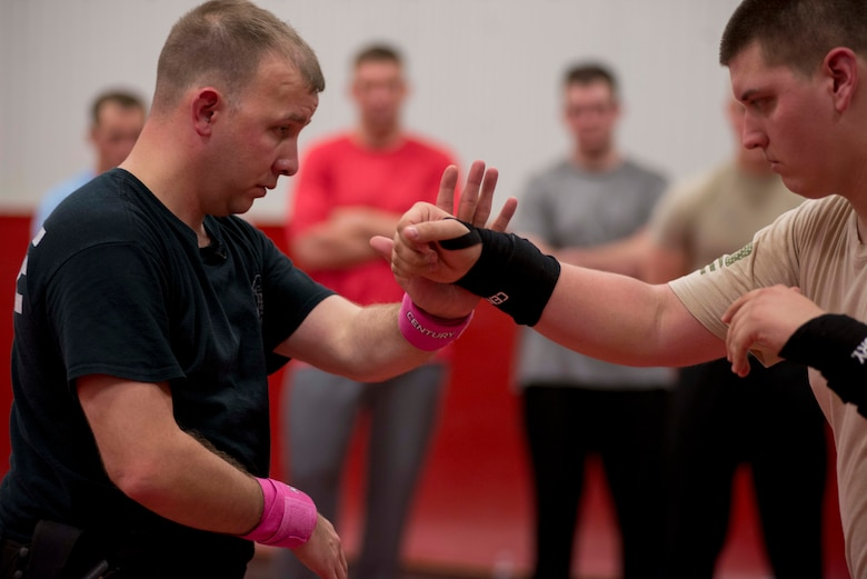 Staff Sgt. Justin Talbert and Senior Airman Brandon Strickland, members of the 138th Security Forces Squadron, demonstrate combative techniques during annual training on Feb. 11, 2017 in Collinsville, OK. Talbert leads this training for the 138th SFS airmen each year to ensure mission readiness. (U.S. Air Force photo by Senior Airman Rebecca Imwalle)