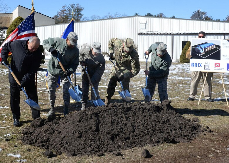 Members of the official party break ground on a 25,000-square-foot enlisted dormitory during a groundbreaking ceremony on base March 13. Participating in the ceremony, from left-to-right, is Allen Shaffi, BBIX partner; Airman 1st Class Kenzie Williams, Dorm Council president; Command Chief Master Sgt. Patricia L. Hickey; Army Col. Christopher Barron, commander of Army Corps of Engineers New England District; and Col. Roman L. Hund, installation commander. (U.S. Air Force photo by Linda LaBonte Britt)