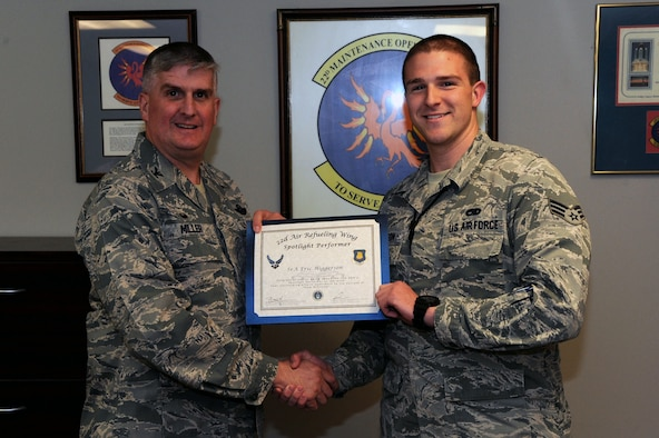 Senior Airman Eric Higgerson, 22nd Maintenance Group maintenance scheduler, poses with Col. Albert Miller, 22nd Air Refueling Wing commander, March 13, 2017, at McConnell Air Force Base, Kan. Higgerson received the spotlight performer for the week of Feb. 13–17. (U.S. Air Force photo/Airman 1st Class Jenna K. Caldwell)