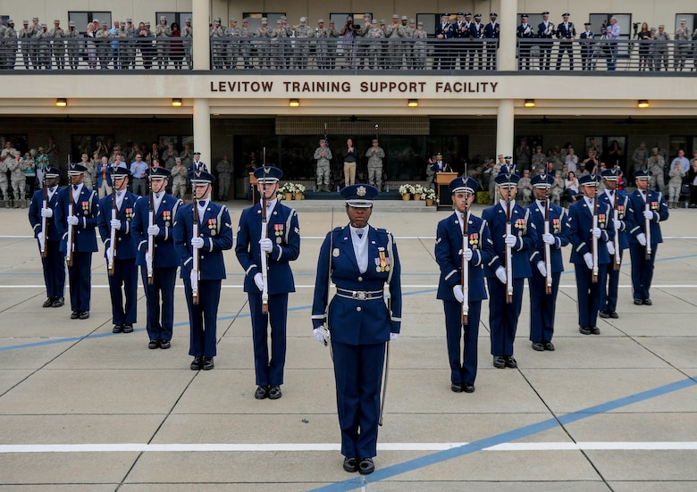 The U.S. Air Force Honor Guard Drill Team debuts their 2017 routine during the 81st Training Group drill down at the Levitow Training Support Facility drill pad March 10, 2017, on Keesler Air Force Base, Miss. The team comes to Keesler every year for five weeks to develop a new routine that they will use throughout the year. (U.S. Air Force photo by Capt. David J. Murphy)