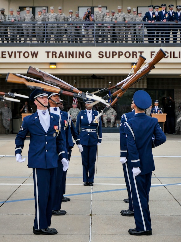 The U.S. Air Force Honor Guard Drill Team debutes their 2017 routine during the 81st Training Group drill down at the Levitow Training Support Facility drill pad March 10, 2017, on Keesler Air Force Base, Miss. The team comes to Keesler every year for five weeks to develop a new routine that they will use throughout the year. (U.S. Air Force photo by Capt. David J. Murphy)
