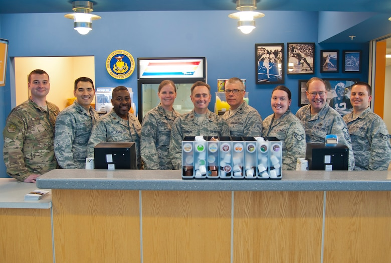 The Minot chapel staff poses in their juice and coffee bar where they serve Airmen free refreshments at Minot Air Force Base, N.D., March 13, 2017. The staff was awarded with the Charles I. Carpenter Award for being the Air Force's Outstanding Large Chapel Team. (U.S. Air Force photo/Senior Airman Christian Sullivan)