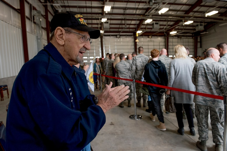 Retired Command Chief Master Sergeant George Banasky welcomes home Airmen from deployment during a ceremony at the 138th Fighter Wing in Tulsa, Okla., March 5, 2017. Banasky is a member of the Silver Beavers, a Heritage Committee made up of retired members of the 138th FW. (U.S. Air National Guard photo by Senior Airman Rebecca Imwalle)