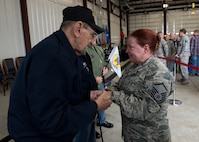 Retired Command Chief Master Sergeant George Banasky, (left) speaks with Master Sgt. Darlene Kirk during a homecoming ceremony at the 138th Fighter Wing in Tulsa, Okla., March 5, 2017. Members of the Silver Beavers and Blue Star Mothers attended this event to show their support of the Airmen who deployed and to welcome them home. (U.S. Air National Guard photo by Senior Airman Rebecca Imwalle)