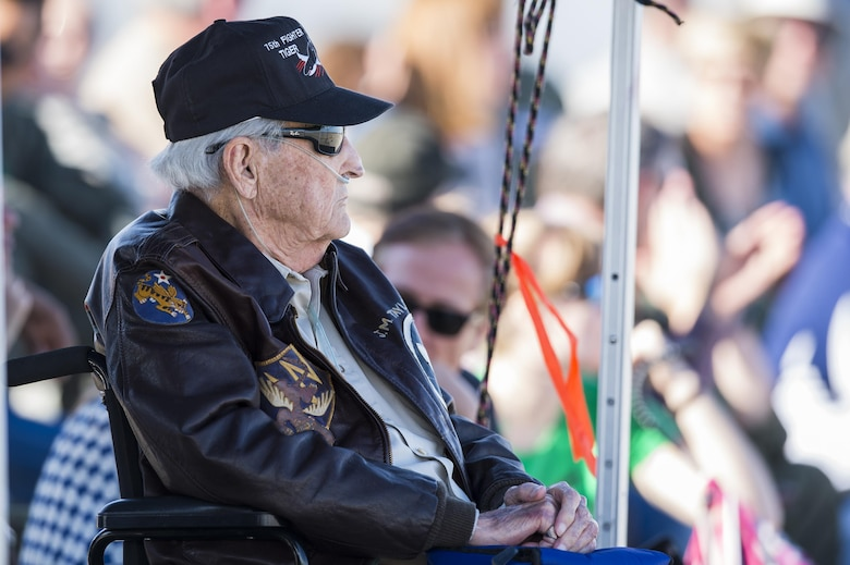 J.M. Taylor, World War II veteran and prisoner of war, watches a combat search and rescue demonstration during the 75th Anniversary Flying Tiger Reunion, March 10, 2017, at Moody Air Force Base, Ga. In 1941, President Roosevelt signed an executive order forming the American Volunteer Group. The AVG was organized into the 1st, 2nd, and 3rd Pursuit Squadrons and later disbanded and replaced by the 23d Fighter Group in 1942. Under the command of Gen. Claire Chennault, the Flying Tigers comprised of the 74th, 75th, and 76th Pursuit Squadrons defended China against the Japanese. Throughout World War II, the Flying Tigers achieved combat success and flew the US-made Curtiss P-40 Warhawks painted with the shark-mouth design. (U.S. Air Force photo by Senior Airman Ceaira Young)