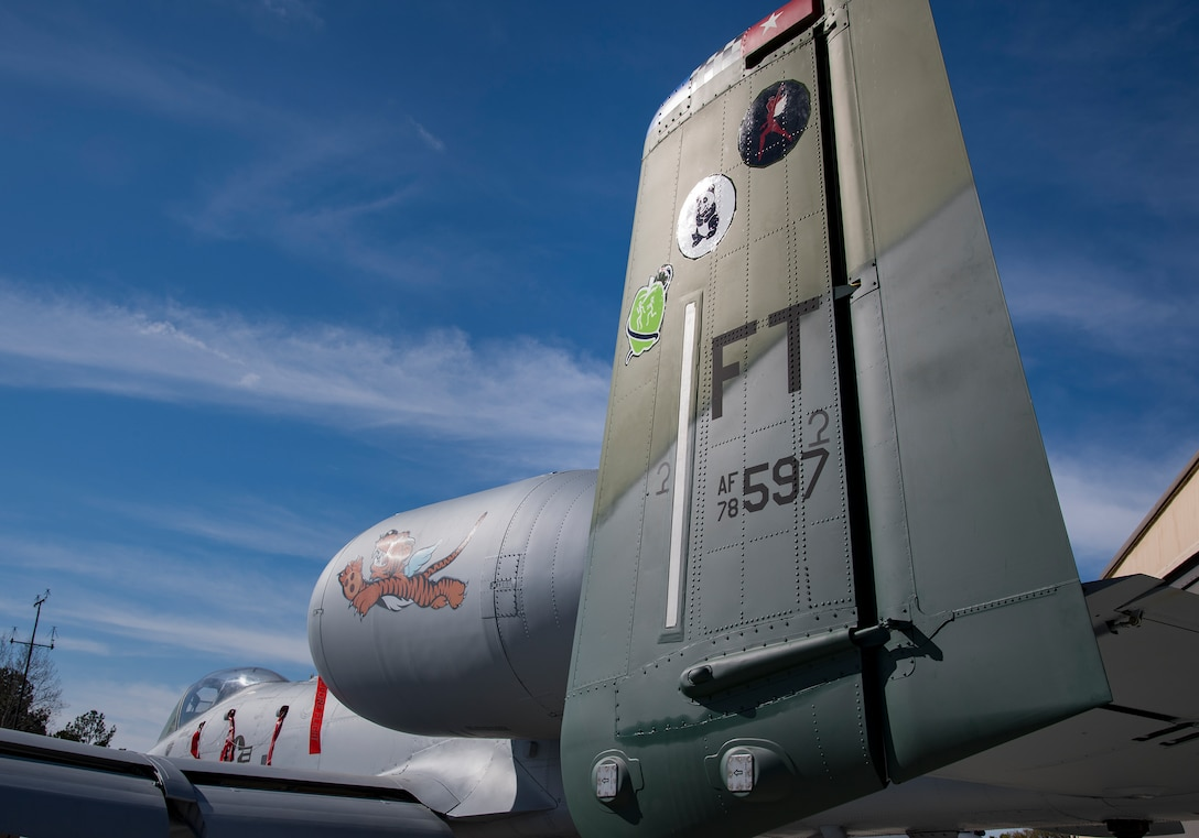 An A-10C Thunderbolt II decorated with heritage patches rests on the flight line during the 75th Anniversary Flying Tiger Reunion, March 10, 2017, at Moody Air Force Base, Ga. In 1941, President Roosevelt signed an executive order forming the American Volunteer Group. The AVG was organized into the 1st, 2nd, and 3rd Pursuit Squadrons and later disbanded and replaced by the 23d Fighter Group in 1942. Under the command of Gen. Claire Chennault, the Flying Tigers comprised of the 74th, 75th, and 76th Pursuit Squadrons defended China against the Japanese. Throughout World War II, the Flying Tigers achieved combat success and flew the US-made Curtiss P-40 Warhawks painted with the shark-mouth design. (U.S. Air Force photo by Senior Airman Ceaira Young)