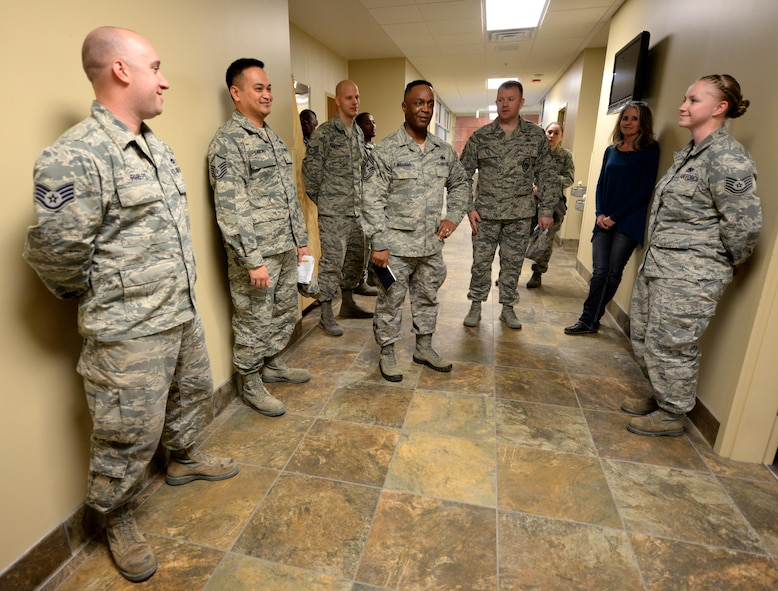 Chief Master Sgt. Calvin Williams, Air Force Global Strike Command command chief, center, meets with Airmen assigned to the 28th Logistics Readiness Squadron during a visit to Ellsworth Air Force Base, S.D., March 2, 2017. The 28th LRS Airmen showed Williams around the base's deployment center while briefing about the deployment process at Ellsworth. (U.S. Air Force photo by Airman 1st Class Denise M. Jenson)