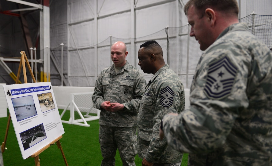 Technical Sgt. Matthew Lee, kennel master assigned to the 28th Security Forces Squadron, talks about the specifics of the indoor military working dog facility to Chief Master Sgt. Calvin Williams, Air Force Global Strike Command command chief, and Chief Master Sgt. Adam Vizi, 28th Bomb Wing command chief, during a visit to Ellsworth Air Force Base, S.D., March 2, 2017. The indoor facility is unique to Ellsworth as the only one of its kind in AFGSC. (U.S. Air Force photo by Airman 1st Class Denise M. Jenson)
