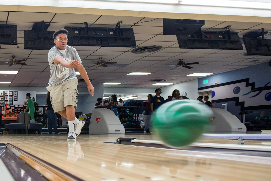 Jacob Thomas participates in a bowling event