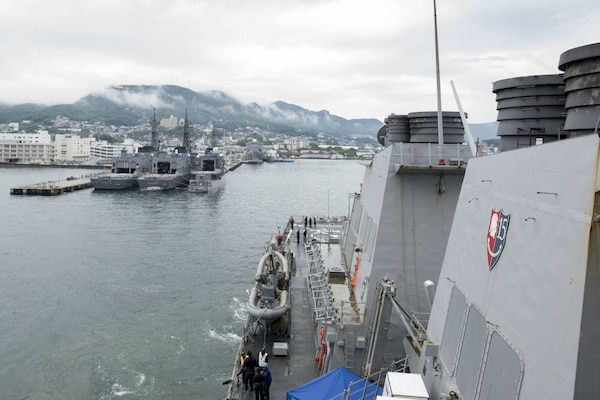 File photo on the Arleigh Burke-class guided-missile destroyer USS Curtis Wilbur (DDG 54) pulls into Sasebo, Japan for a scheduled port visit. Curtis Wilbur is on patrol with Carrier Strike Group Five (CSG 5) supporting security and stability in the Indo-Asia-Pacific region.