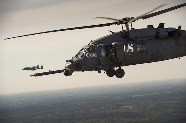 An HH-60G Pave Hawk and an A-10C Thunderbolt II fly as part of a combat Search and rescue demonstration during the 75th Anniversary Flying Tiger Reunion, March 10, 2017, at Moody Air Force Base, Ga. In 1941, President Roosevelt signed an executive order forming the American Volunteer Group. The AVG was organized into the 1st, 2nd, and 3rd Pursuit Squadrons and later disbanded and replaced by the 23d Fighter Group in 1942. Under the command of Gen. Claire Chennault, the Flying Tigers comprised of the 74th, 75th, and 76th Pursuit Squadrons defended China against the Japanese. Throughout World War II, the Flying Tigers achieved combat success and flew the US-made Curtiss P-40 Warhawks painted with the shark-mouth design. (U.S. Air Force photo by Tech. Sgt. Zachary Wolf)