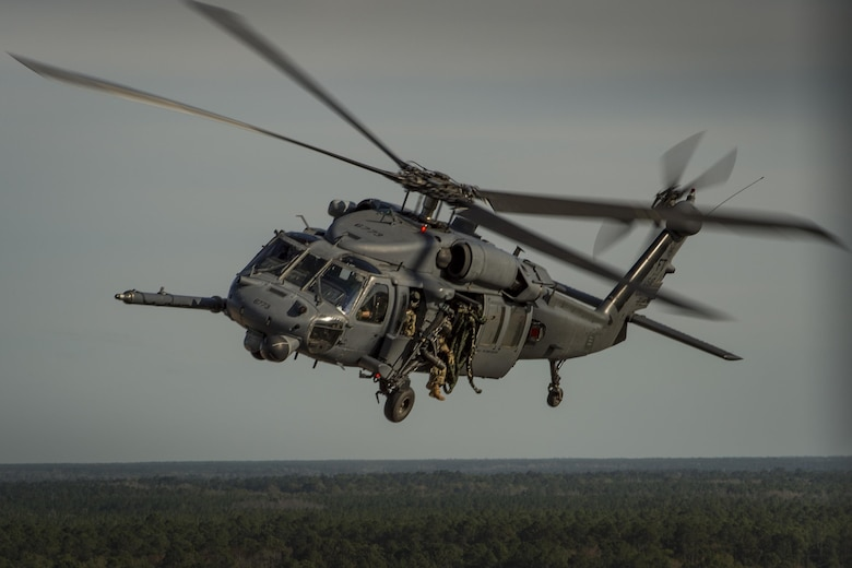 An HH-60G Pave Hawk from the 41st Rescue Squadron, flies as part of a combat search and rescue demonstration during the 75th Anniversary Flying Tiger Reunion, March 10, 2017, at Moody Air Force Base, Ga. In 1941, President Roosevelt signed an executive order forming the American Volunteer Group. The AVG was organized into the 1st, 2nd, and 3rd Pursuit Squadrons and later disbanded and replaced by the 23d Fighter Group in 1942. Under the command of Gen. Claire Chennault, the Flying Tigers comprised of the 74th, 75th, and 76th Pursuit Squadrons defended China against the Japanese. Throughout World War II, the Flying Tigers achieved combat success and flew the US-made Curtiss P-40 Warhawks painted with the shark-mouth design. (U.S. Air Force photo by Tech. Sgt. Zachary Wolf)