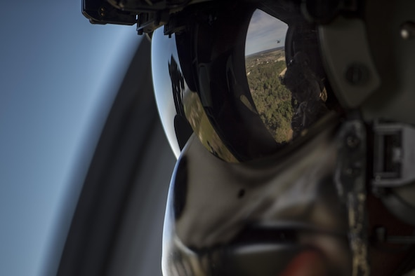 Staff Sgt. David Stringer, 41st Rescue Squadron special missions aviator, watches out of an HH-60G Pave Hawk during a combat search and rescue demonstration as one part of the 75th Anniversary Flying Tiger Reunion, March 10, 2017, at Moody Air Force Base, Ga. In 1941, President Roosevelt signed an executive order forming the American Volunteer Group. The AVG was organized into the 1st, 2nd, and 3rd Pursuit Squadrons and later disbanded and replaced by the 23d Fighter Group in 1942. Under the command of Gen. Claire Chennault, the Flying Tigers comprised of the 74th, 75th, and 76th Pursuit Squadrons defended China against the Japanese. Throughout World War II, the Flying Tigers achieved combat success and flew the US-made Curtiss P-40 Warhawks painted with the shark-mouth design. (U.S. Air Force photo by Tech. Sgt. Zachary Wolf)