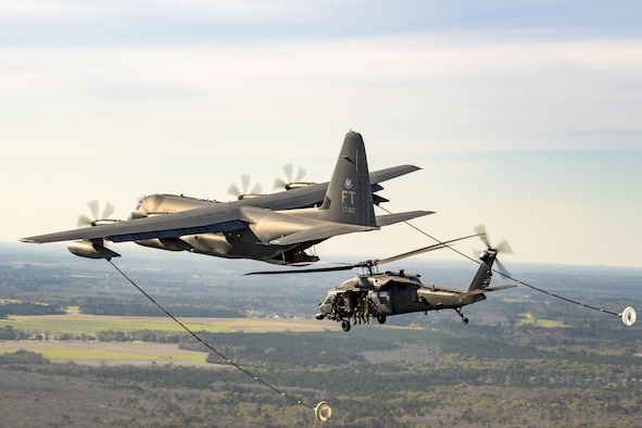 Refuel An HC-130J Combat King II and an HH-60G Pave Hawk conduct a refueling demonstration during the 75th Anniversary Flying Tiger Reunion, March 10, 2017, at Moody Air Force Base, Ga. In 1941, President Roosevelt signed an executive order forming the American Volunteer Group. The AVG was organized into the 1st, 2nd, and 3rd Pursuit Squadrons and later disbanded and replaced by the 23d Fighter Group in 1942. Under the command of Gen. Claire Chennault, the Flying Tigers comprised of the 74th, 75th, and 76th Pursuit Squadrons defended China against the Japanese. Throughout World War II, the Flying Tigers achieved combat success and flew the US-made Curtiss P-40 Warhawks painted with the shark-mouth design. (U.S. Air Force photo by Staff Sgt. Ryan Callaghan)