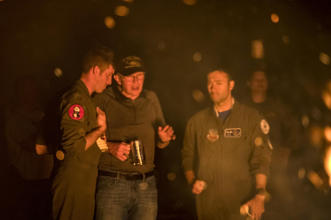 A-10C Thunderbolt II pilots from the 23d Fighter Group speak with a former member of the Flying Tigers at a piano burn during the 75th Anniversary Flying Tiger Reunion, March 10, 2017, at Moody Air Force Base, Ga. In 1941, President Roosevelt signed an executive order forming the American Volunteer Group. The AVG was organized into the 1st, 2nd, and 3rd Pursuit Squadrons and later disbanded and replaced by the 23d Fighter Group in 1942. Under the command of Gen. Claire Chennault, the Flying Tigers comprised of the 74th, 75th, and 76th Pursuit Squadrons defended China against the Japanese. Throughout World War II, the Flying Tigers achieved combat success and flew the US-made Curtiss P-40 Warhawks painted with the shark-mouth design. (U.S. Air Force photo by Staff Sgt. Ryan Callaghan)