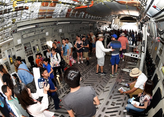 Airshow patrons wait in line to see the cock-pit of a U.S. Air Force C-17 Globemaster III cargo aircraft assigned to the 97th Air Mobility Wing, March 11, 2017 at Naval Air Facility El Centro, California. A C-17 and a U.S. Air Force KC-135 Stratotanker air refueling aircraft from Altus Air Force Base, Oklahoma were used as a static displays during the airshow while the aircrews engaged with the airshow attendees about the importance of the aircraft and Altus AFB's mission. (U.S. Air Force photo by Airman 1st Class Kirby Turbak/Released)