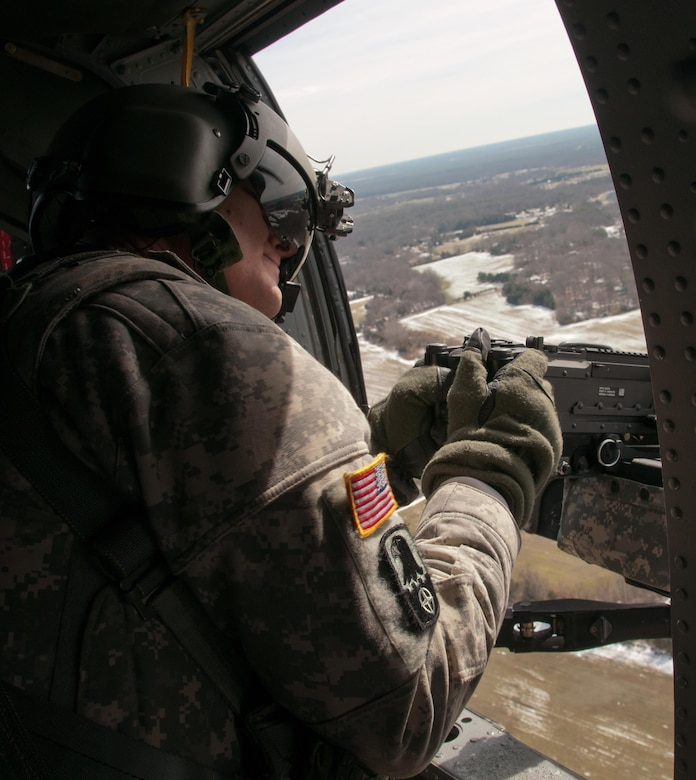 An Army Reserve crew chief, assigned to 8th Battalion, 229th Aviation Regiment, based out of Fort Knox, Ky., scans his sector of fire from a UH-60 Black Hawk Helicopter above Lakehurst Maxfield Field during a multi-component airfield seizure training exercise between the Army Reserve and the 101st Airborne Division on March 13, 2017 to kick off Warrior Exercise 78-17-01. Several Army Reserve organizations including the Army Reserve Aviation Command, 84th Training Command, 78th Training Division, and members of the 200th Military Police Command helped Easy Company, 2nd Battalion, 506th Parachute Infantry Regiment, 101st Airborne Division conduct the mission. Roughly 60 units from the U.S. Army Reserve, U.S. Army, U.S. Air Force, and Canadian Armed Forces are participating in the 84th Training Command's joint training exercise, WAREX 78-17-01, at Joint Base McGuire-Dix-Lakehurst from March 8 until April 1, 2017; the WAREX is a large-scale collective training event designed to assess units' combat capabilities as America's Army Reserve continues to build the most capable, combat-ready, and lethal Federal Reserve force in the history of the Nation.