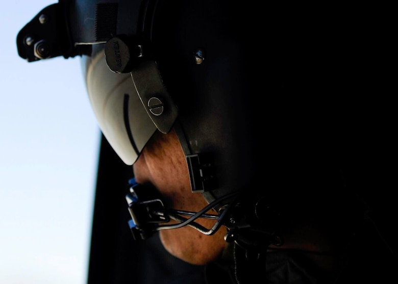 A Singapore air force crew chief looks out the window of a CH-47 Chinook during a Red Flag 17-2 combat search and rescue mission over the Nevada Test and Training Range, March 6, 2017. For 20 years in Grand Prairie, Texas, the Singapore air force has worked in unison with its pilots, air crews and the United States Army. (U.S. Air Force photo by Airman 1st Class Kevin Tanenbaum/Released)