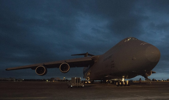 Staff Sgt. Pierre Manivong, 22nd Airlift Squadron, prepares to do a pre-flight walkaround of a C-5M Super Galaxy March 7, 2017 at Yokota Air Base, Japan. The C-5M is participating in a Pacific channel mission, flying to Japan and South Korea to deliver various cargo throughtout the Pacific region. (U.S. Air Force photo/Staff Sgt. Nicole Leidholm)