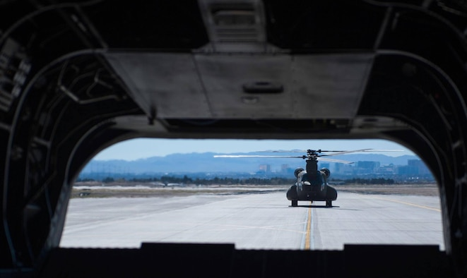 A Singapore air force CH-47 Chinook taxis down the flightline at Nellis Air Force Base, Nev., before a combat search and rescue mission during Red Flag 17-2, March 6, 2017. Red Flag has exposed the Singapore air force to new variables, and it also granted new pilots with leadership experience. (U.S. Air Force photo by Airman 1st Class Kevin Tanenbaum/Released)
