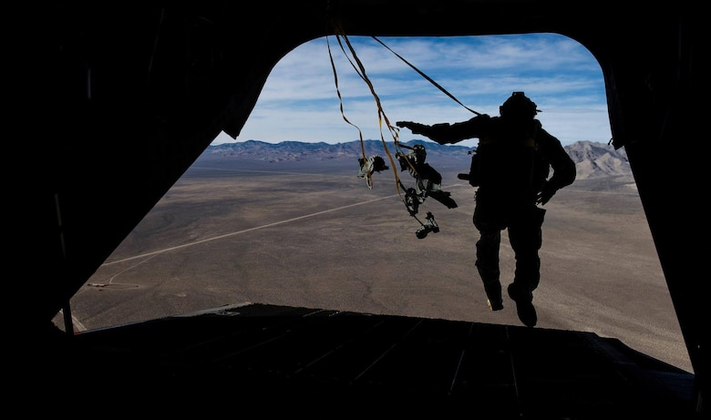 A Survival, Evasion, Resistance, and Escape specialist performs a static line jump out of a CH-47 Chinook during a Red Flag 17-2 mission over the Nevada Test and Training Range, March 7, 2017. Red Flag provides vital training and real world scenarios that progress Singapore Air Force air crews to the next level in their skills. (U.S. Air Force photo by Airman 1st Class Kevin Tanenbaum/Released)