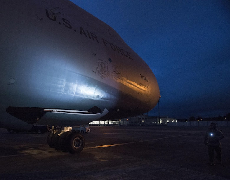 Staff Sgt. Piere Manivong, 22nd AS, completes a pre-flight inspection of a C-5M Super Galaxy prior to a flight March 7, 2017 from Yokota Air Base, Japan, to Osan Air Base, South Korea. As a flight engineer, Manivong is responsible for completing pre-flight inspections of the aircraft prior to the pilots coming on board to ensure everything is safe for the flight.  (U.S. Air Force photo/Staff Sgt. Nicole Leidholm)
