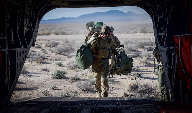 Survival, Evasion, Resistance, and Escape (SERE) specialist are picked up by a CH-47 Chinook after performing static-line jumps on the Nevada Test and Training Range, during Red Flag 17-2, March 7, 2017. SERE specialists lead the Air Force emergency parachuting program and conduct extensive testing of parachuting systems. They are uniquely suited to analyze the operating environment to plan for evasion, captivity, and recovery considerations. (U.S. Air Force photo by Airman 1st Class Kevin Tanenbaum/Released)