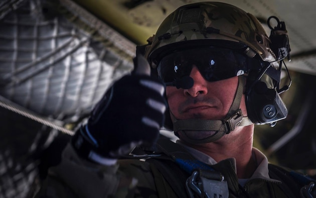 A Survival, Evasion, Resistance, and Escape specialist gives the thumbs up before performing a static-line jump during Red Flag 17-2 over the Nevada Test and Training Range, March 7, 2017. Search and rescue operations during Red Flag improve efficiency and readiness for future real world operations. (U.S. Air Force photo by Airman 1st Class Kevin Tanenbaum/Released)