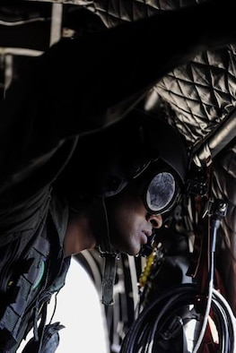 A Singapore air force crew chief looks out the window of a CH-47 Chinook before Survival, Evasion, Resistance, and Escape specialist perform static-line jumps over the Nevada Test and Training Range, during Red Flag 17-2, March 7, 2017. Flying units from around the globe deploy to Nellis Air Force Base, Nev., to participate in Red Flag. (U.S. Air Force photo by Airman 1st Class Kevin Tanenbaum/Released)