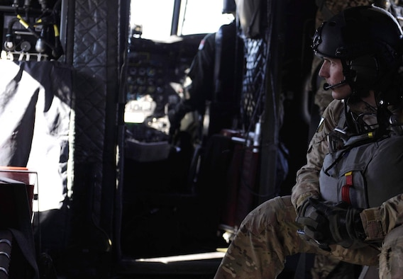 A Survival, Evasion, Resistance, and Escape (SERE) specialist, sits on a CH-47 Chinook before performing a static-line jump over the Nevada Test and Training Range, during Red Flag 17-2, March 7, 2017. A static line is a fixed cord attached to a large, stable object and is used to open parachutes automatically. (U.S. Air Force photo by Airman 1st Class Kevin Tanenbaum/Released)