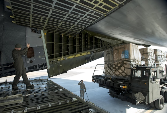Senior Airman Elias Wilson, 22nd Airlift Squadron, marshals in a K-loader with pallets of household goods March 7, 2017, at Osan Air Base, South Korea. A total of 14 pallets of household goods were returned back to the United States for service members who are being reassigned duty stations. (U.S. Air Force photo by Staff Sgt. Nicole Leidholm)