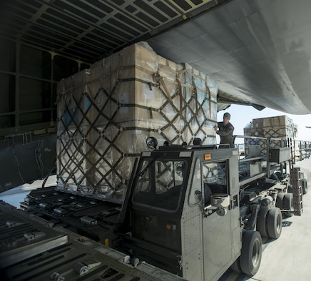 Senior Airman Elias Wilson, 22nd Airlift Squadron, loads pallets of household goods March 7, 2017, at Osan Air Base, South Korea. A total of 14 pallets of household goods were returned back to the United States for service members who are being reassigned duty stations. (U.S. Air Force photo by Staff Sgt. Nicole Leidholm)
