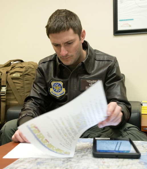 Capt. Brett Boudreaux, 22nd Airlift Squadron, goes over the flight plan March 9, 2017, for the day's mission from Osan Air Base, South Korea, to Yokota Air Base, Japan. Boudreaux was on a Pacific channel mission, flying cargo from Osan AB to Travis Air Force Base, Calif. (U.S. Air Force photo by Staff Sgt. Nicole Leidholm)
