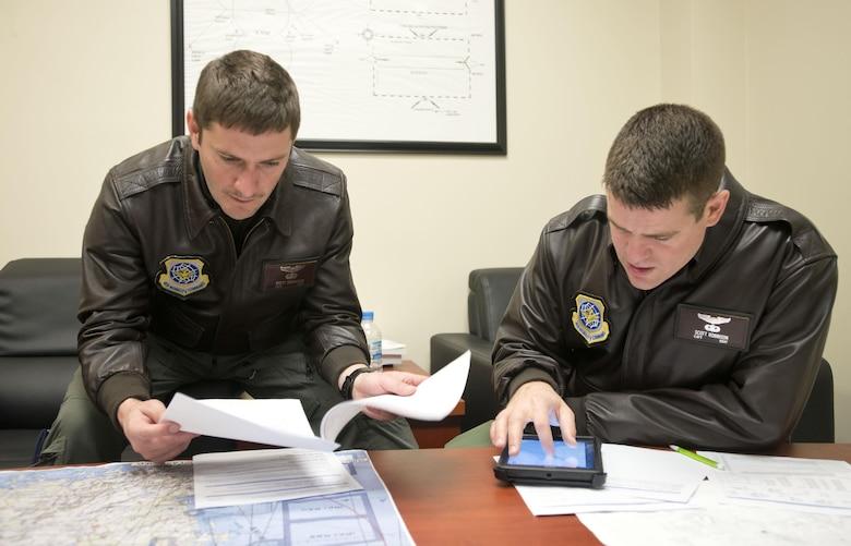 Capt. Brett Boudreaux, left, and Capt. Scott Robinson, assigned to the 22nd Airlift Squadron, go over the flight plan March 9, 2017, for the day's mission from Osan Air Base, South Korea, to Yokota Air Base, Japan. The pilots were on what's called a Pacific channel mission, flying cargo from Osan AB to Travis Air Force Base, California. (U.S. Air Force photo by Staff Sgt. Nicole Leidholm)