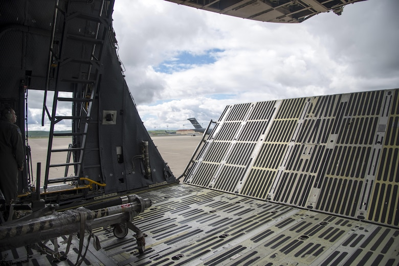 Tech. Sgt. Isaac Nunez, 60th Aircraft Maintenance Squadron, closes the forward ramp extension and visor prior to a departure March 4, 2017, for Yokota Air Base, Japan. Nunez, along with members of the 22nd Airlift Squadron flew a Pacific channel mission to Yokota AB and Osan AB, South Korea, delivering cargo and space-available passengers. (U.S. Air Force photo by Staff Sgt. Nicole Leidholm)