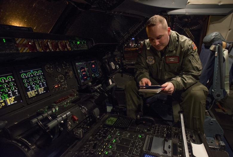 Tech Sgt. Timothy McCarthy, 22nd AS, completes a pre-flight inspection of the flight controls March 7 2017, on a C-5M Super Galaxy at Yokota Air Base, Japan. As a flight engineer, McCarthy is responsible for completing pre-flight inspections of the aircraft prior to the pilots coming on board to ensure everything is safe for the flight. (U.S. Air Force photo/Staff Sgt. Nicole Leidholm)