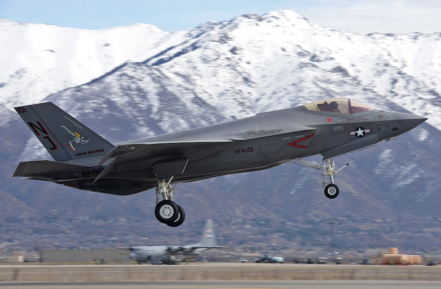 "U.S. Air Force F-35 test pilot, Lt. Col. Kevin ""Sonar"" Hall, flies a low approach March 9 at Hill Air Force Base, Utah, during a functional check flight in a Navy F-35C Lightning II. (U.S. Air Force Photo by Alex R. Lloyd)"