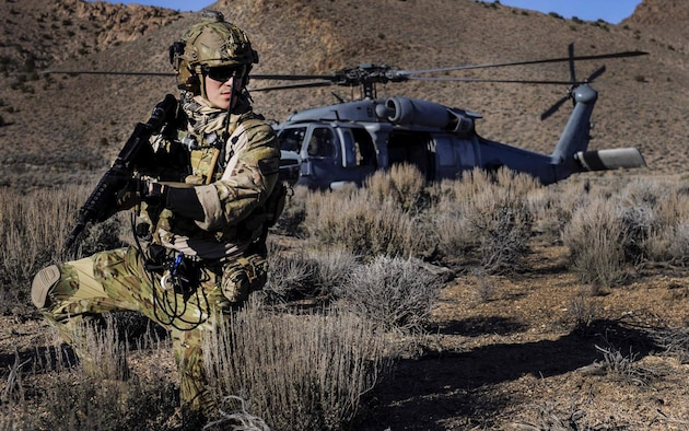 A pararescueman provides cover as a simulated injured pilot is recovered during a Red Flag 17-2 combat search and rescue mission on the Nevada Test and Training Range, March 8, 2017. Air Force pararescuemen are the only Department of Defense elite combat forces specifically organized, trained, equipped and postured to conduct full spectrum personnel recovery, to include both conventional and unconventional combat rescue operations. (U.S. Air Force photo by Airman 1st Class Kevin Tanenbaum/Released)