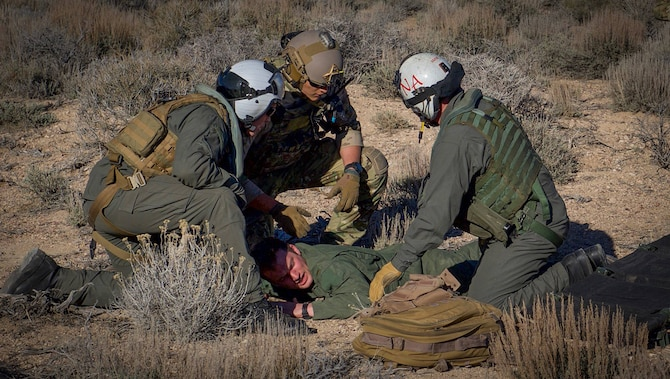 Pararescuemen examine a simulated downed pilot during a Red Flag 17-2 combat search and rescue mission on the Nevada Test and Training Range, March 8, 2017. Red Flag provides combat training in a degraded and operationally limited environment making the training missions as realistic as possible. (U.S. Air Force photo by Airman 1st Class Kevin Tanenbaum/Released)