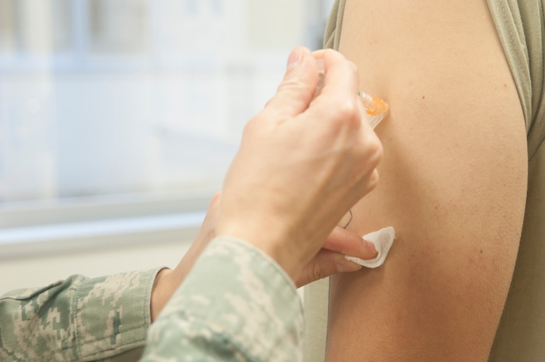 An Airman receives a vaccine March 14, 2017, at Kadena Air Base, Japan. Medical readiness is one thing held high on the priority list for members preparing to deploy. Ensuring your shot records are current year-round can save time, and a few extra pinches, when the tasking comes in. (U.S. Air Force photo by Airman 1st Class Quay Drawdy)