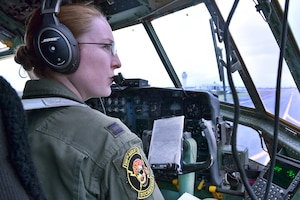 Puerto Rico Air National Guard Capt. Heather Kindred talks to the air traffic control tower from the flightline before a mission to commemorate International Women's Day at Muñiz Air National Guard Base, Puerto Rico, March 9, 2017. Kindred is a pilot assigned to the 156th Airlift Wing. Air National Guard photo by Master Sgt. Edgar Morell